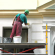 图库照片: Restoration works. house painter