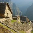Hut at machu picchu - Stock Photo