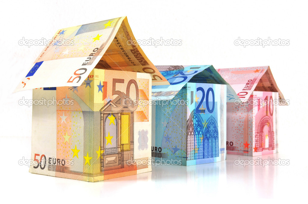 Three houses in various sizes with banknotes from 10 to 50 Euro isolated on white background — Stock Photo #2665420