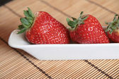 Close-up of strawberries in a white pot — Stock Photo
