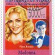 Постер, плакат: Madonna and actor Pierce Brosnan