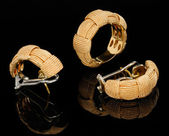 Two golden earrings and ring