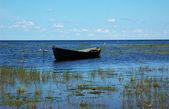 Wooden boat near the lake bank