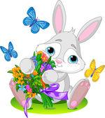Cute little bunny giving a bouquet