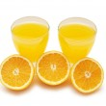 thumbnail of Half-cut oranges and fresh orange juice