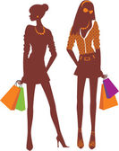 Two Shopping girls silhouettes