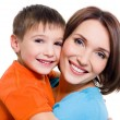 thumbnail of Appy cheerful mother with little son