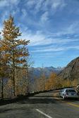 Car on narrow, twisty mountain road