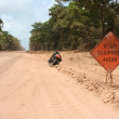 thumbnail of Lone bicycle on dusty road in Belize