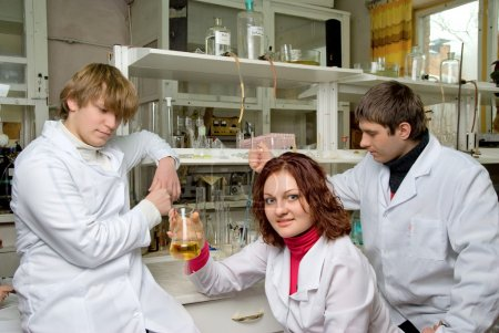 Постер, плакат: Young scientists in laboratory, холст на подрамнике
