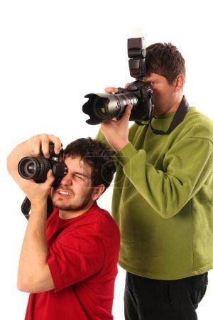 Постер, плакат: Professional photographers in action, холст на подрамнике