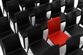 červené křeslo mezi černé židle