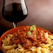 thumbnail of Ragu pasta and glass of wine