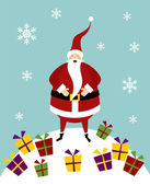 Felice Babbo Natale in piedi su una montagna di neve con un sacco di regali colorati