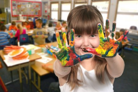 School Age Child Painting With Her Hands