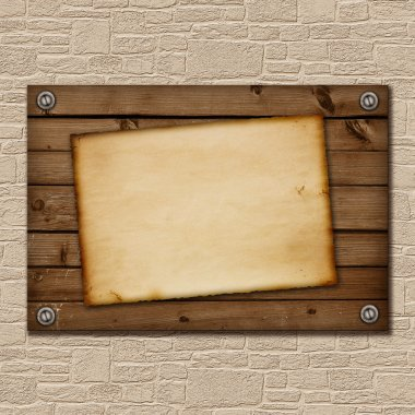 Old piece of paper on a wooden board