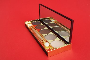 Eye shadows on a red background