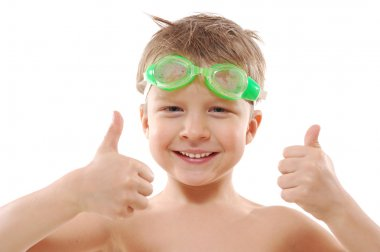 Child with goggles and thumbs up