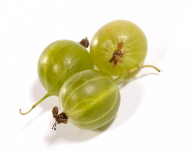 Few gooseberries on bright background wi
