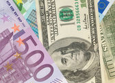 Money background from dollars and euro b