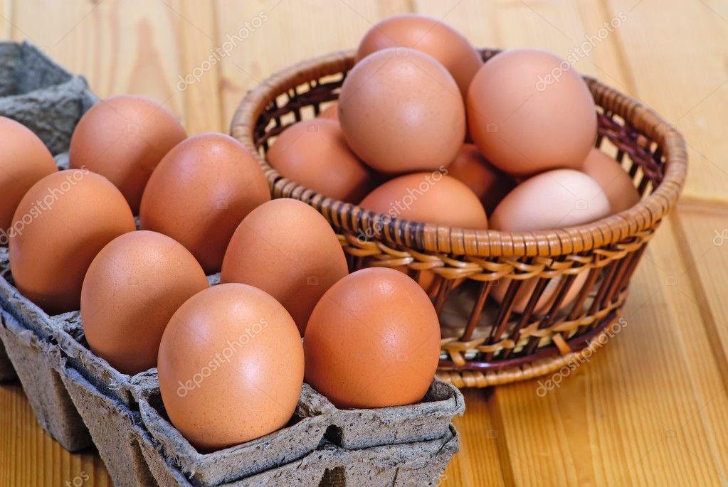 Chicken eggs of brown color in cardboard