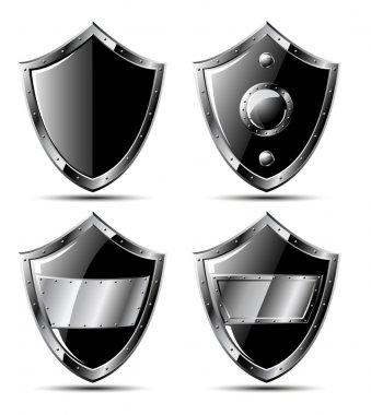 Set of four black steel shields