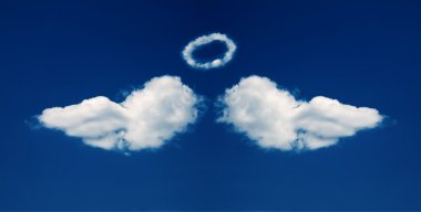 Angel wings and nimbus formed from cloud