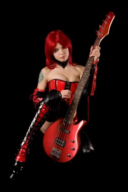Sexy girl with bass guitar