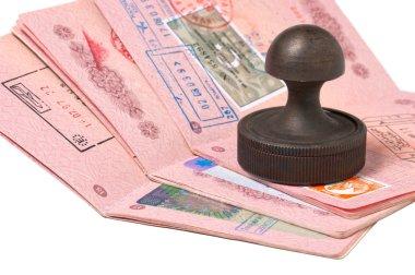 Stack of passports and stamp