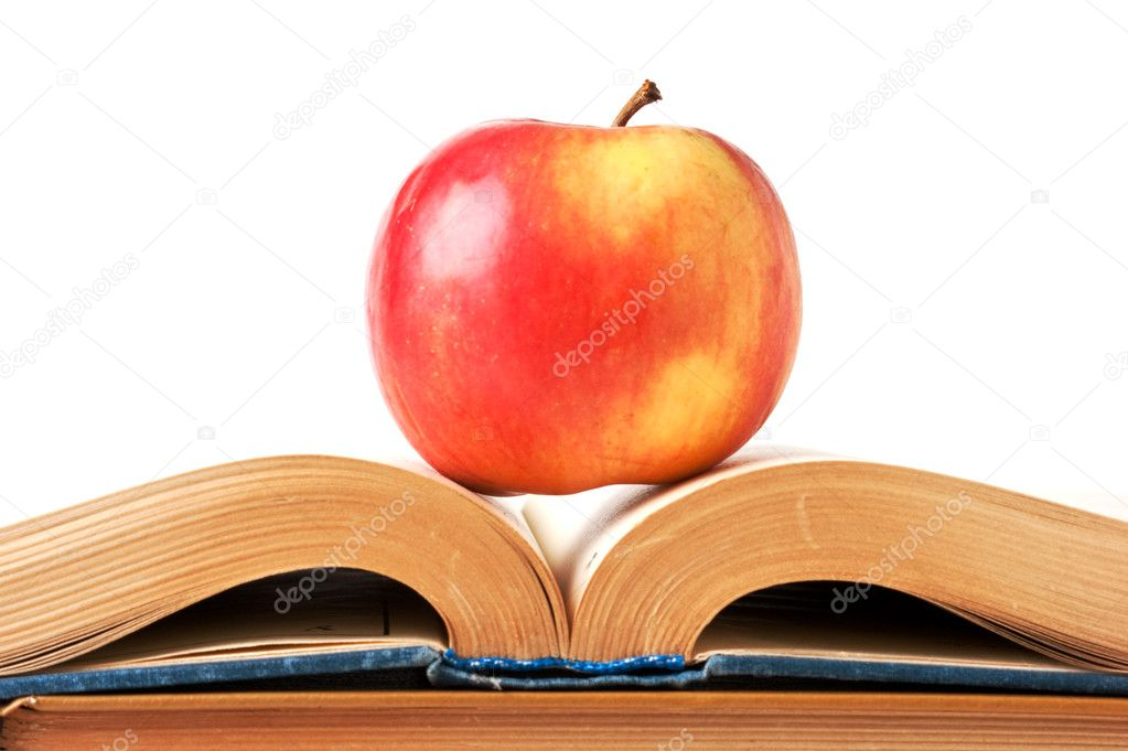 Apple and an open book isolated on white