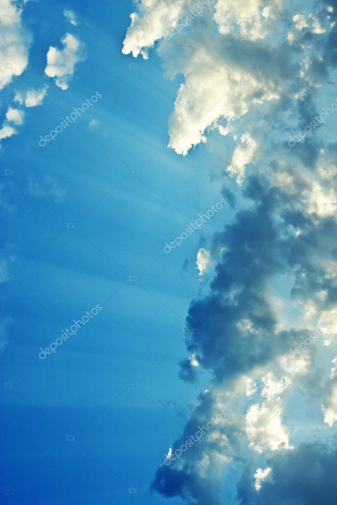 Clouds sky sunbeams