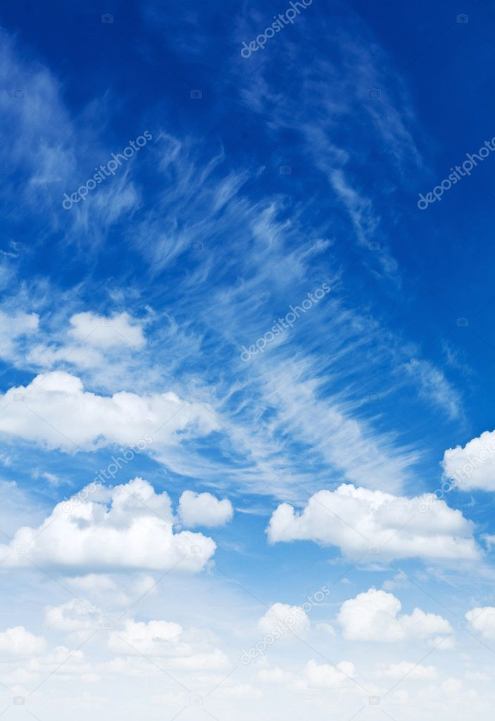 Cumulus and cirrus clouds on a blue sky