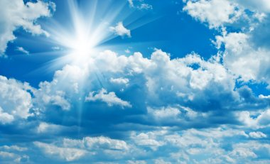 Blue cloudy sky with sun