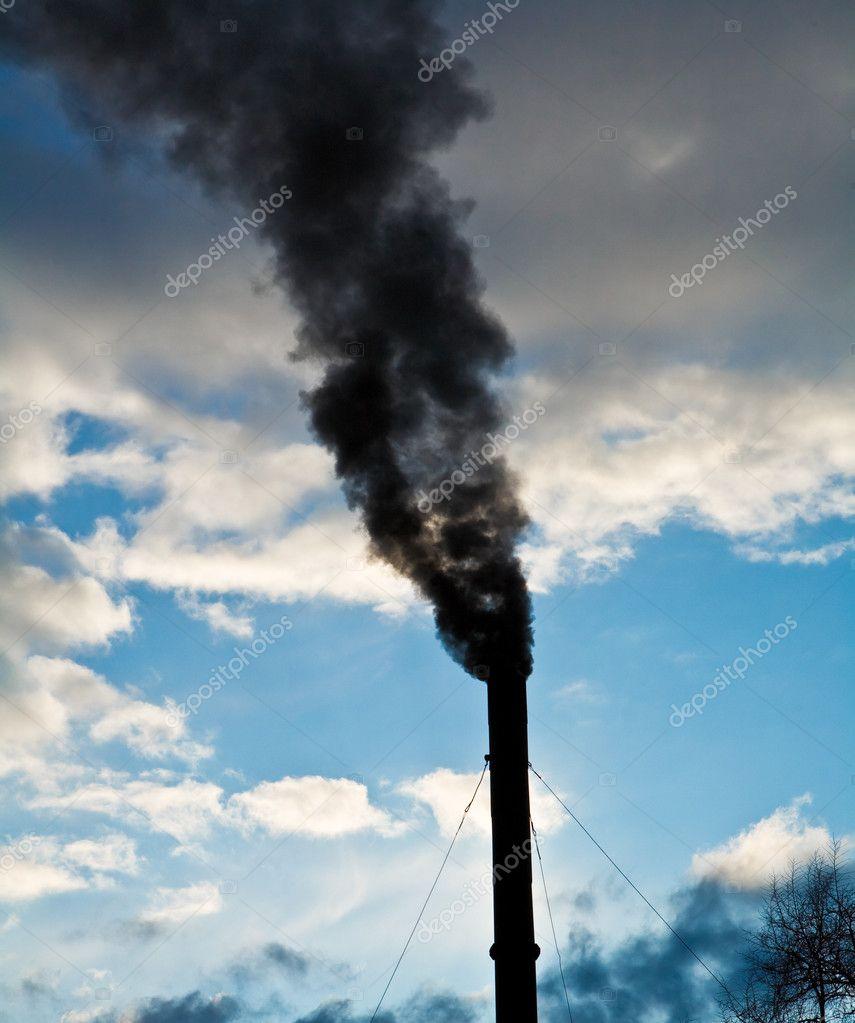 Pipe with a smoke on a sky