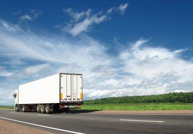 White truck speeding away on highway