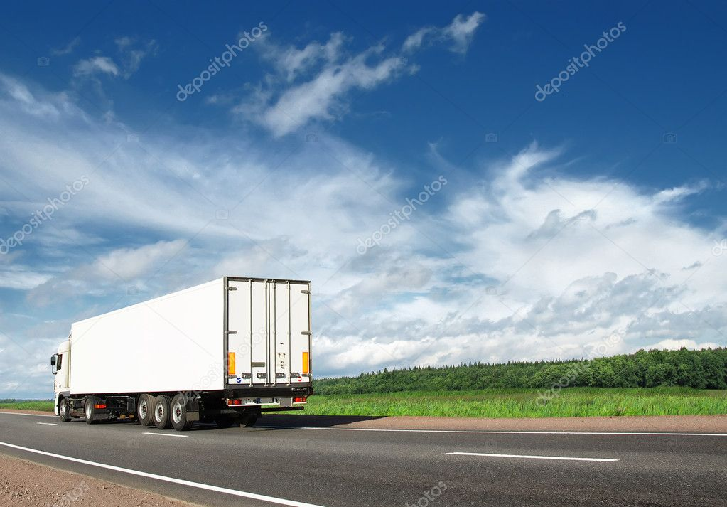 White truck speeding away on highway