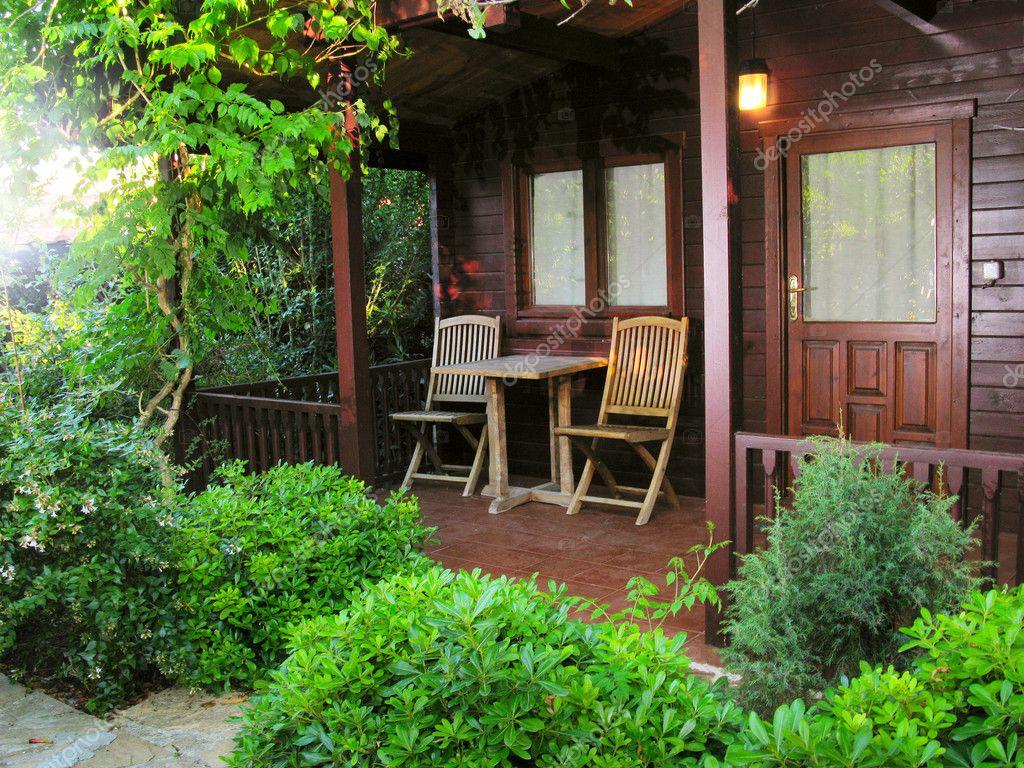 Wooden cottage in the garden