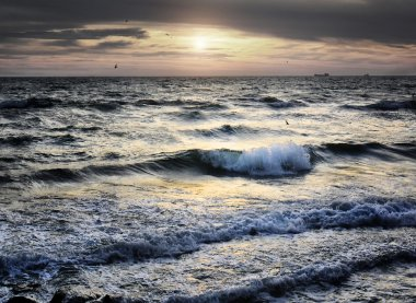 Portrait of sea wave on sunset