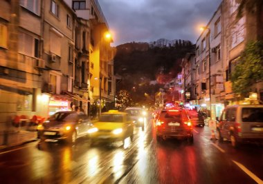 Night traffic in rainy city