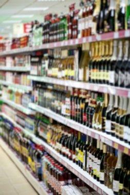 Shelf with beer bottles in a supermarket