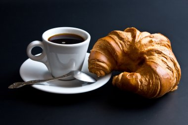 White cup coffee, spoon and croissant