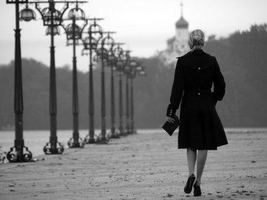 Beautiful blonde on promenade