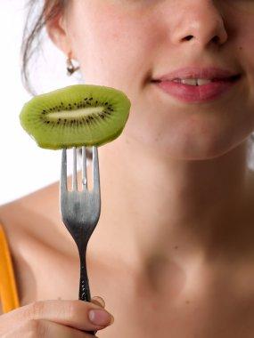 Teen eats kiwi