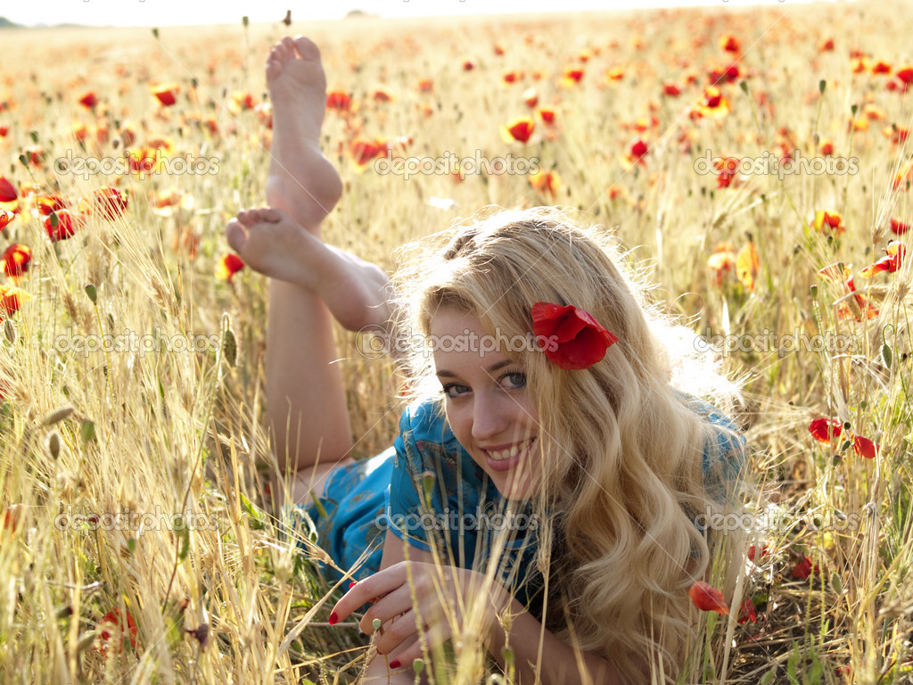 https://static3.depositphotos.com/1000156/107/i/950/depositphotos_1072525-stock-photo-barefoot-blonde-in-poppies.jpg