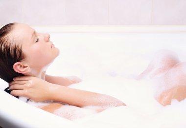 Woman enjoys the bath-foam