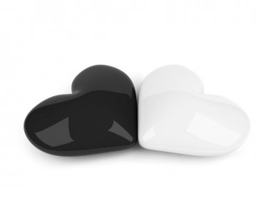 Black and white hearts lying over white