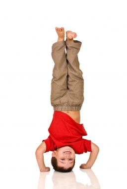 Child standing on a head