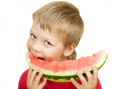 Boy eating a piece of watermelon