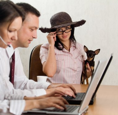 A young man and woman operatin laptops a