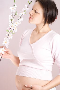 Pregnant girl holding a flowers